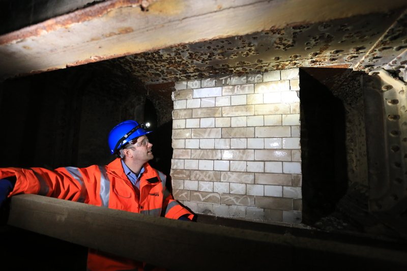 Greg Thornett inspects tiles from the old Southwark Park Railway Station